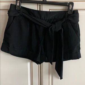 Black short shorts with side zipper and tie